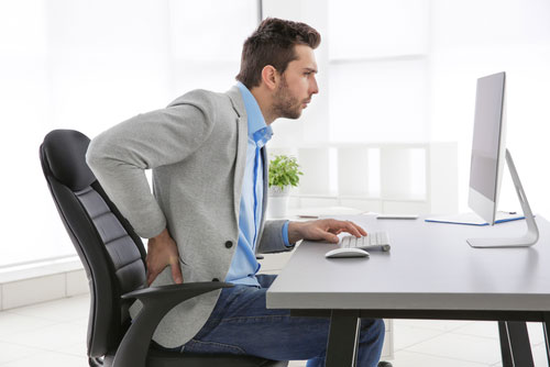 How to adopt a good sitting posture for the back at the office?